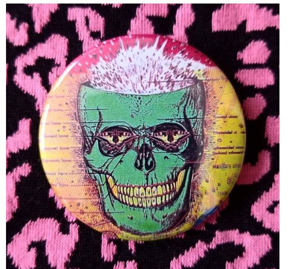 2.25 inch psychedelic green skull button badge pin