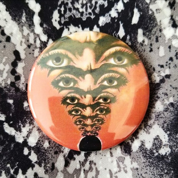 Orange Eyes button badge pin