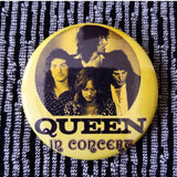 Queen in Concert yellow button badge pin
