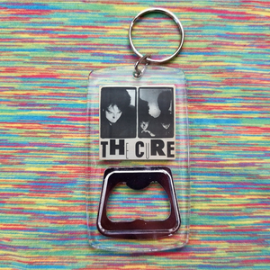 The cure clear bottle opener keychain