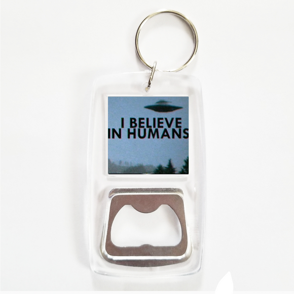 I believe in humans clear bottle opener keychain