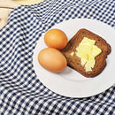 Keto bread next to eggs on a plate