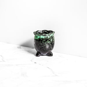 green and black handmade plant pot