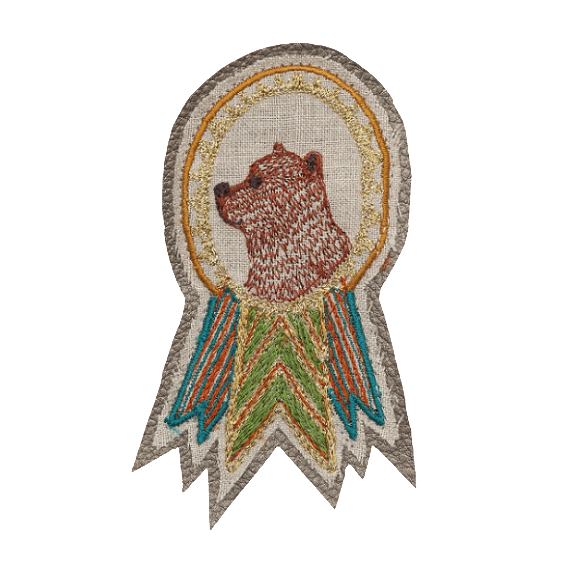 Coral and Tusk Bear Badge Pin