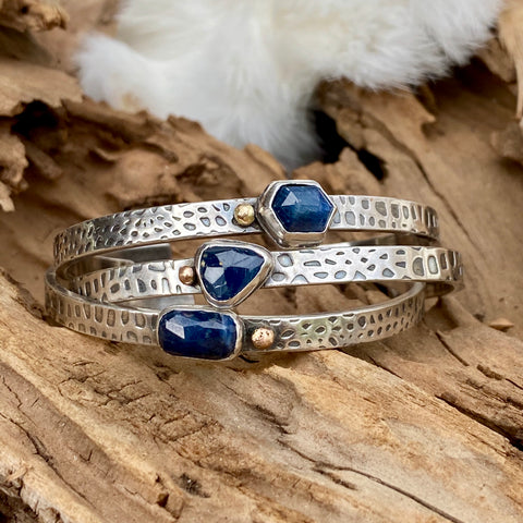 Deep blue Sapphire and gold snakeskin cuffs