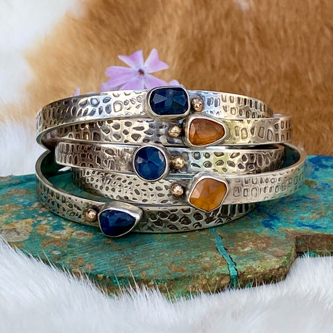 Deep blue Sapphire and golden Garnet and gold snakeskin cuffs