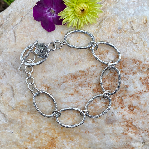 Oval hammered hand cast sterling silver bracelet