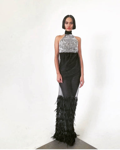 silver sequin bodice halter gown. The skirt is sheer with black overlay and feather trim.