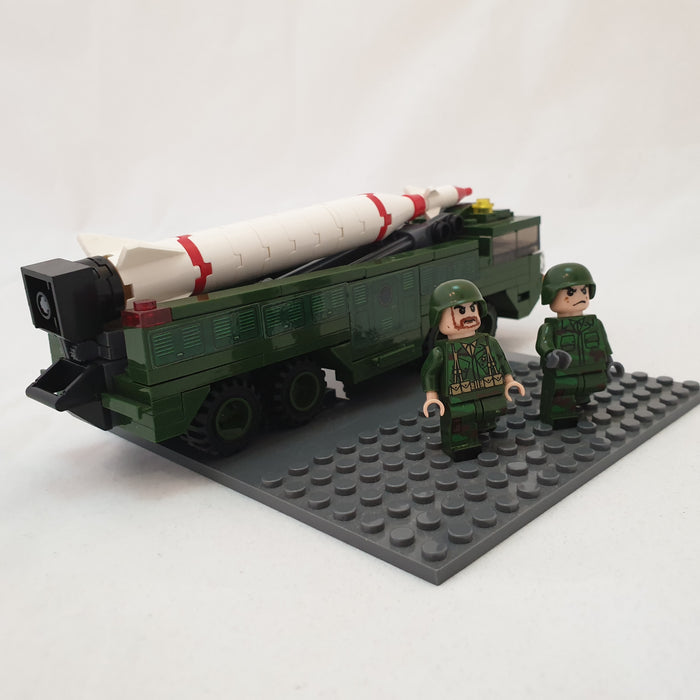 Toy tank and soldiers