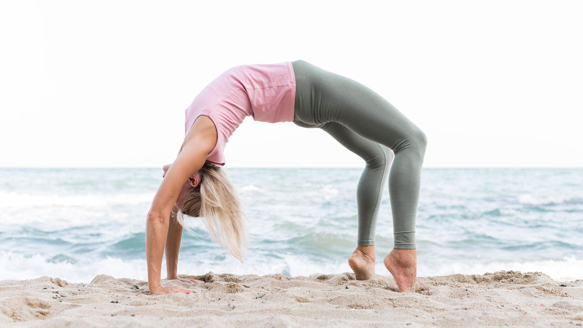 beautiful-yoga-girl-practicing-under-the-sun-outdoors-wearing-activewear-legging-uv-protection
