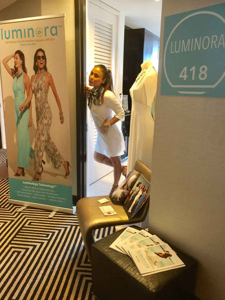 Azi-hendi-founder-creative-director-of-luminora-as-a-leading-uv-protective-clothing-for-women-against-skin-cancer-showing-some-upf+50-fabrics