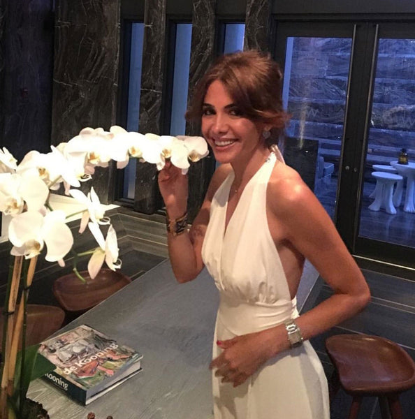 Turkish-newscaster-Julide-Ates-in-white-Murano-Jumpsuit-luminora-coolibar