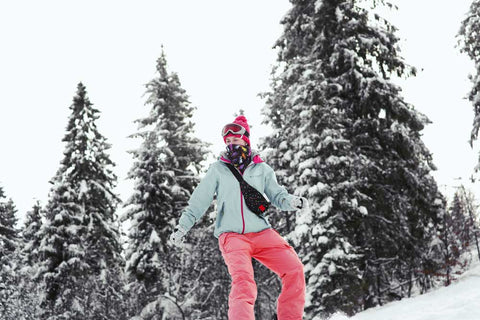 woman-wearing-sun-protective-cloth-legging-and-upf-protective-face-mask-skiing-winter