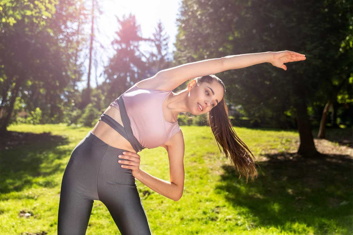 sporty-girl-with-ponytail-doing-physical-exercises-open-air-legging-activewear