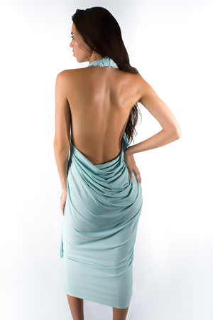 brunette-young-woman-wearing-uv-protective-aqua-color-salerno-wrap-dress-standing-under-the-sun-in-summer-back-view