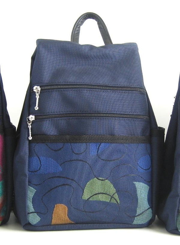 B968-NV Medium Side Entry Backpack in Navy Nylon with Fabric Accent Pocket