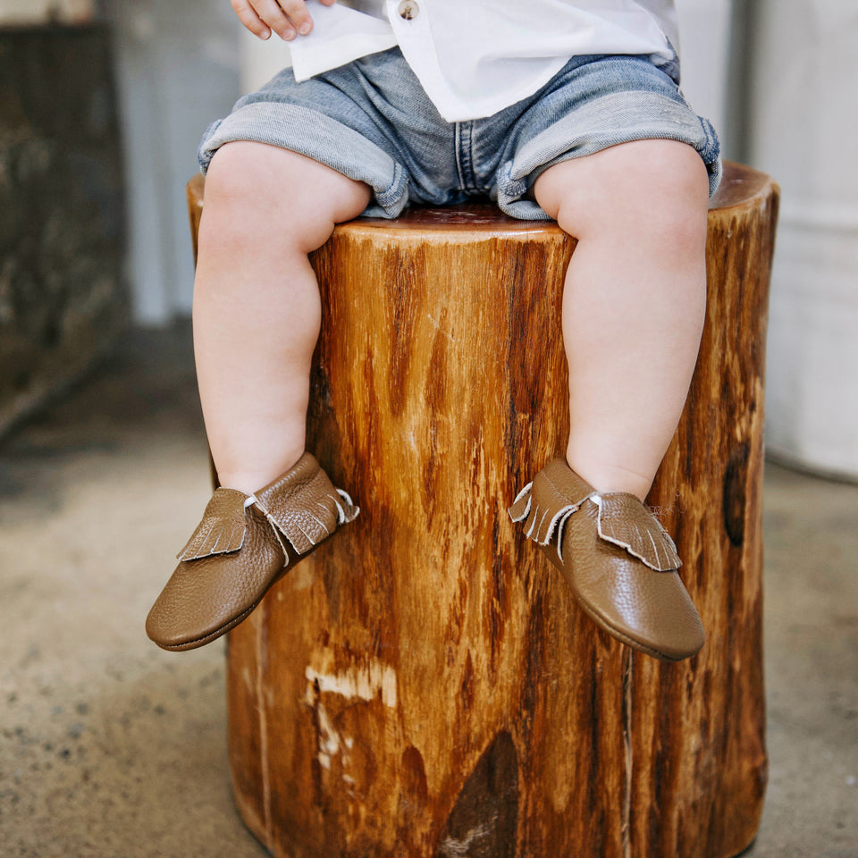 Boy wearing brown leather soft sole shoes