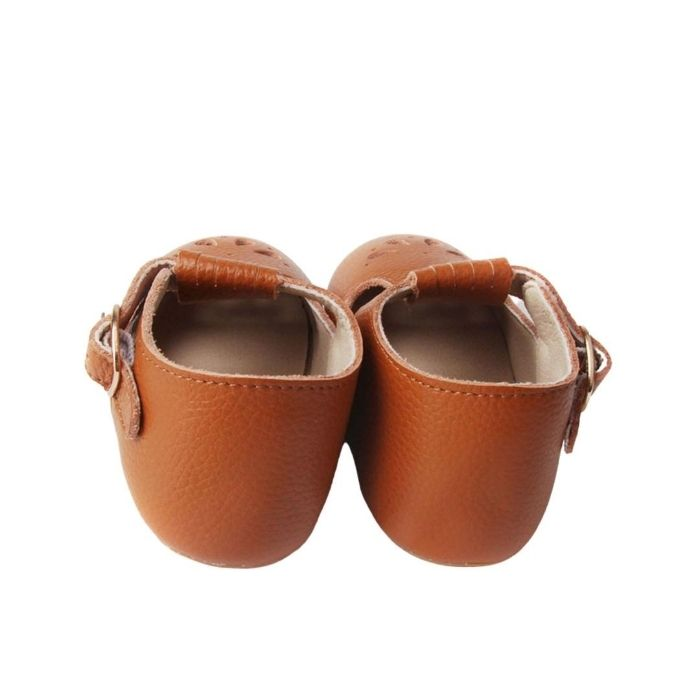Tan Colored Leather T bars shoes petal cutout details over toe faux buckle rear view