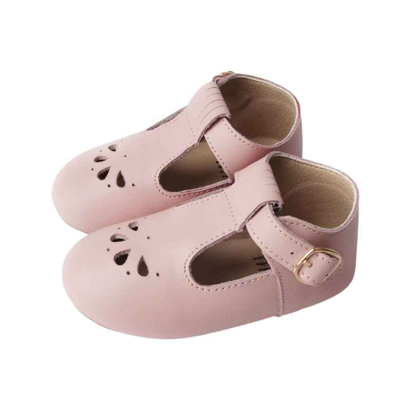 Pastel Pink T bar Leather shoes with petal shape cut out detail over toe side view