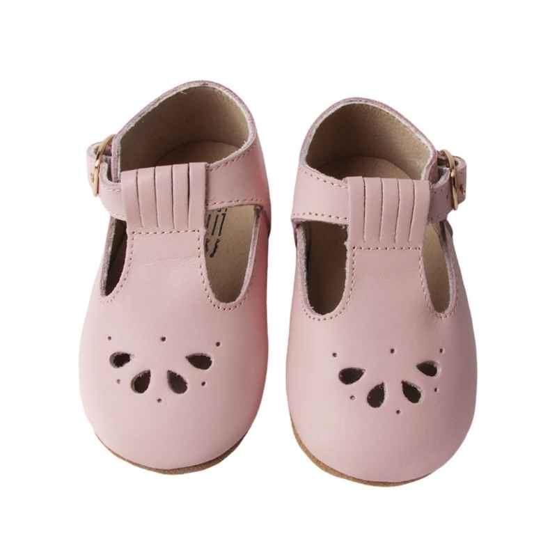 Pastel Pink T bar Leather shoes with petal shape cut out detail over toe top view