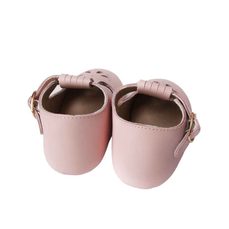 Pastel Pink T bar Leather shoes with petal shape cut out detail over toe rear view