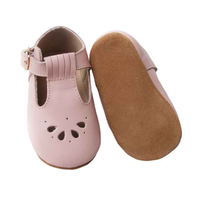 Pastel Pink T bar Leather shoes with petal shape cut out detail over toe sole view