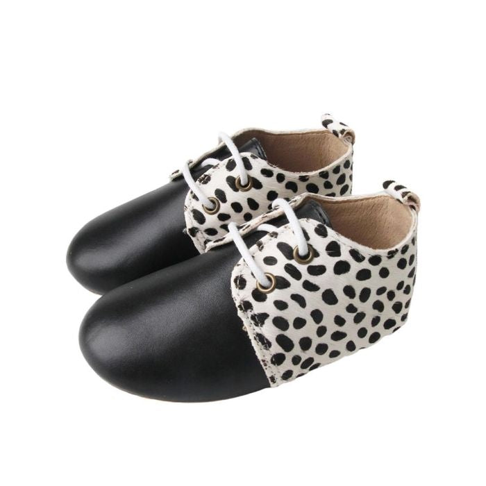 Grip Sole Toddler Boots Animal Print with Black toe lace up side view