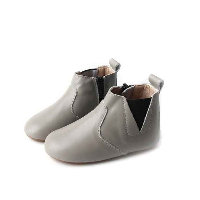 Light grey coloured leather toddler boots. View of the pair from the side. Features elastic ankle closure one side, zip closure opposite side.
