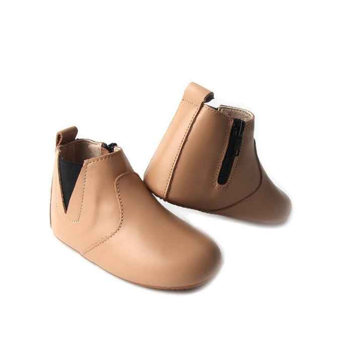 Light brown toddler boots. Pictured heel of one shoe. Stitching detail. Elastic ankle onside. Opposite side zip closure.