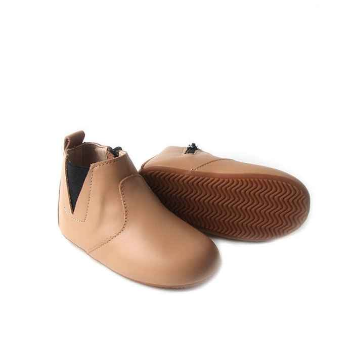 Light tan coloured toddler boot. Image shows flexible rubber sole with grip. Stitching details over the foot.