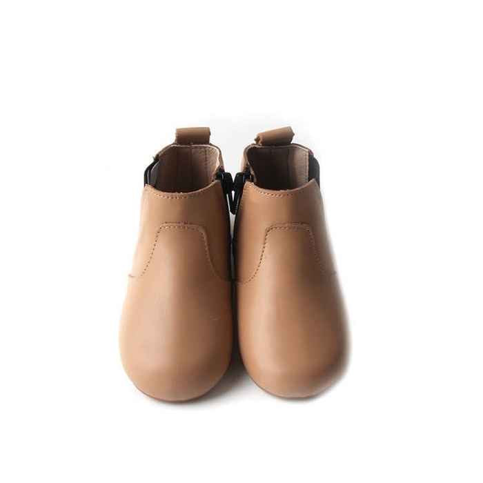 View from above toddler boots in light  tan colour. Featuring stitching detail over the top of foot
