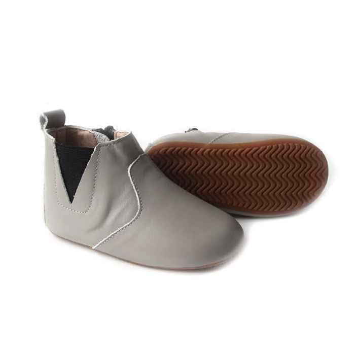 Soft grey leather toddler boots. Showing sole view. Flexible rubber sole.