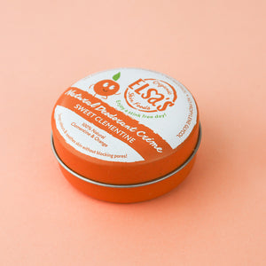 Elsa's Sweet Clementine Crème Deodorant tin on bright yellow background