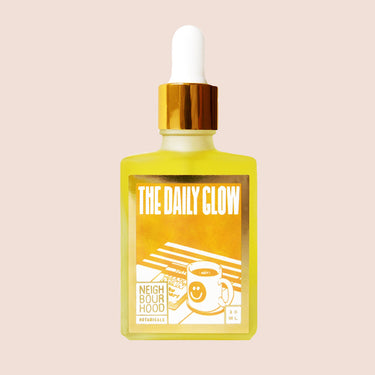 Neighbourhood Botanicals The Daily Glow oil bottle on peach background