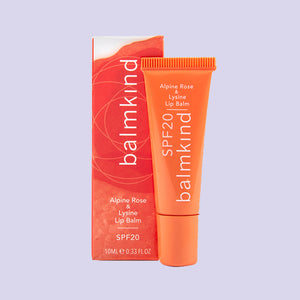 Tube and packaging for Balmkind Alpine Rose & Lysine Lip Balm SPF20