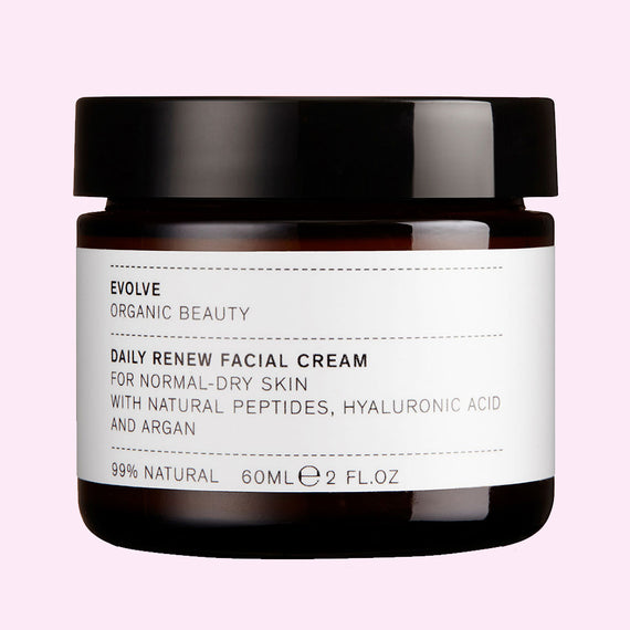 Evolve Daily Renewal Facial Cream tub on pink background