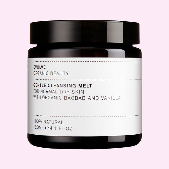 Evolve Gentle Cleansing Melt tub on pink background