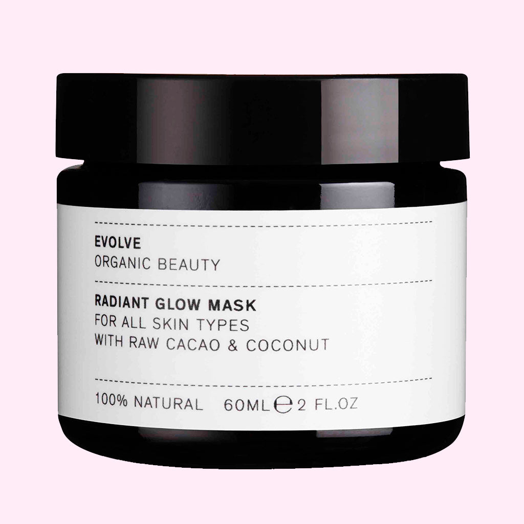 Evolve Radiant Glow Organic Mask tub on pink background