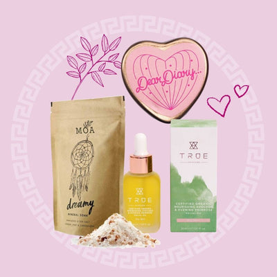 Picture collage featuring MOA Dreamy Mineral soak, True avocado and evening primrose oil, and Neighbourhood botanicals dear diary lip balm. Products placed on pink backdrop with leaf, circular pattern and heart graphics