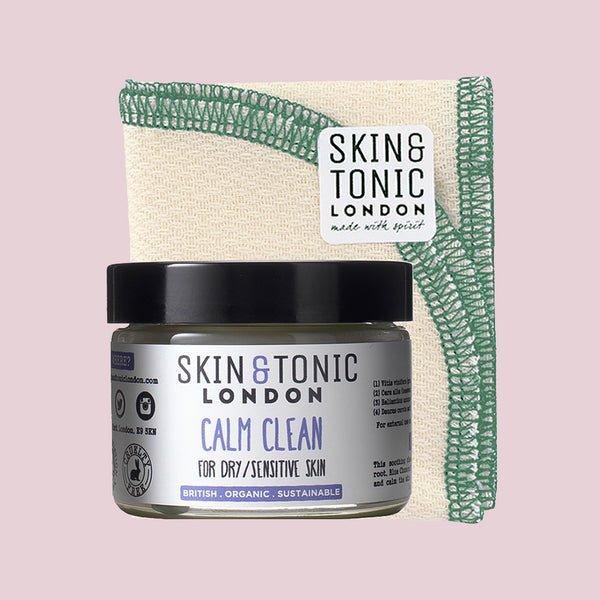 Skin & Tonic Calm Clean screw-top tub, shown alongside cloth with Skin & Tonic logo