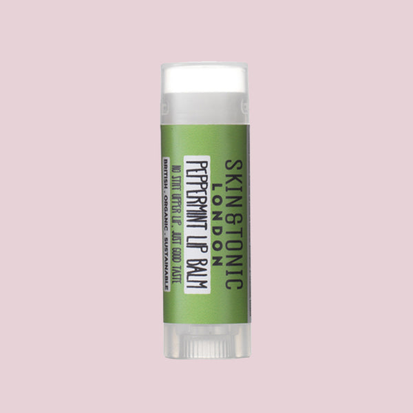 Skin & Tonic Peppermint Lip Balm tube on dusky pink background