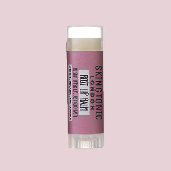 Skin & Tonic Rose Lip Balm tube on dusky pink background