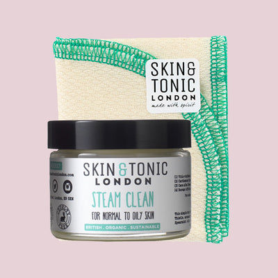 Skin & Tonic Steam Clean screw top tub, shown with cloth and Skin & Tonic logo