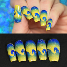 Load image into Gallery viewer, Full nail art manicure with blue and yellow swirls above, with full set of intact removed peelies below