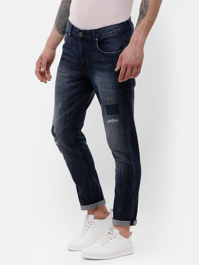 Men's Dark Indigo faded, Rip & Repair denim with indigo patch