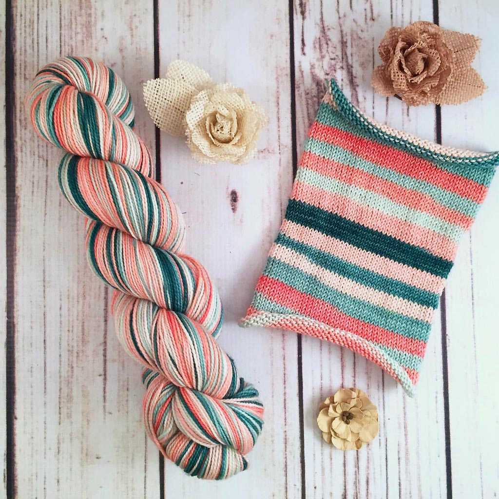 Study In Peach, Mint - hand-dyed self-striping sock yarn