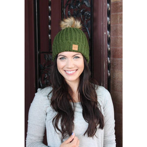 Green fleece lined slouchy knit hat with pom accent.