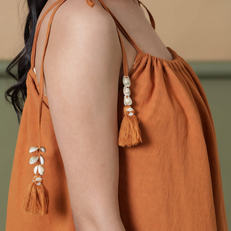 Right Detail of a Model wearing 6-Way Convertible Rust Sandstone Tie Dye Skirt Dress