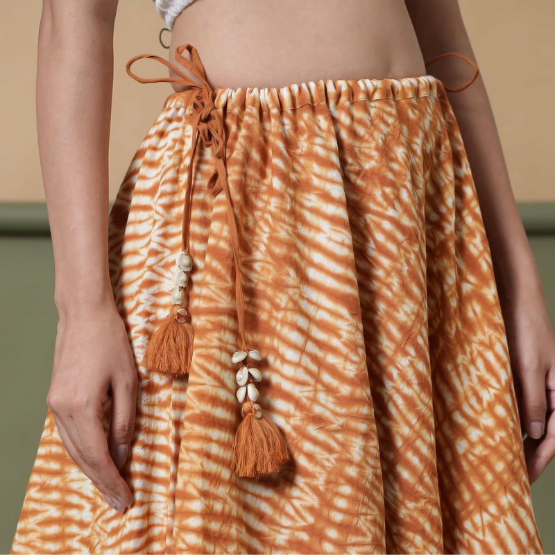 Front Detail of a Model wearing 6-Way Convertible Rust Sandstone Tie Dye Skirt Dress