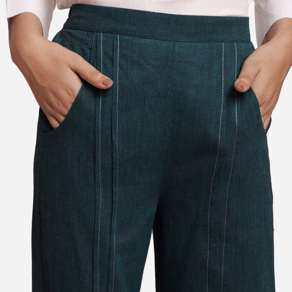 Front Detail of a Model wearing Bottle Green Mid Rise Straight Fit Pant